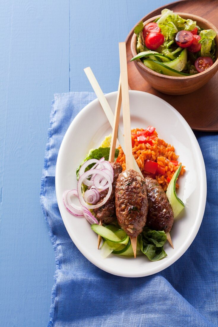 Cevapcici sausages with tomato rice