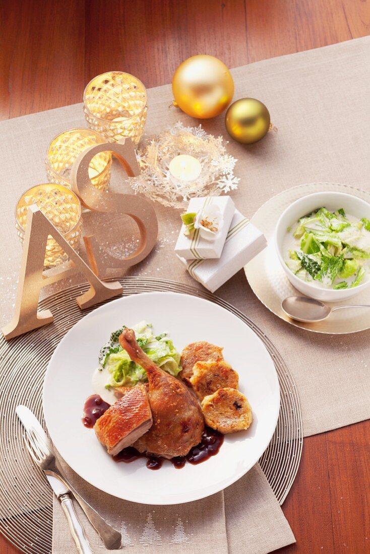 Roast duck with onion sauce, creamy savoy cabbage and napkin dumplings