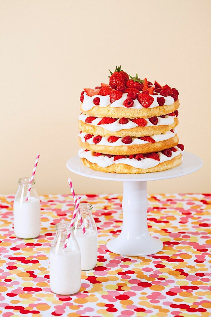 A sponge cake with berries and cream for a child's birthday