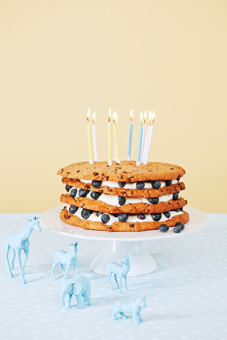 A chocolate chip cookie cake with blueberries for a child's birthday