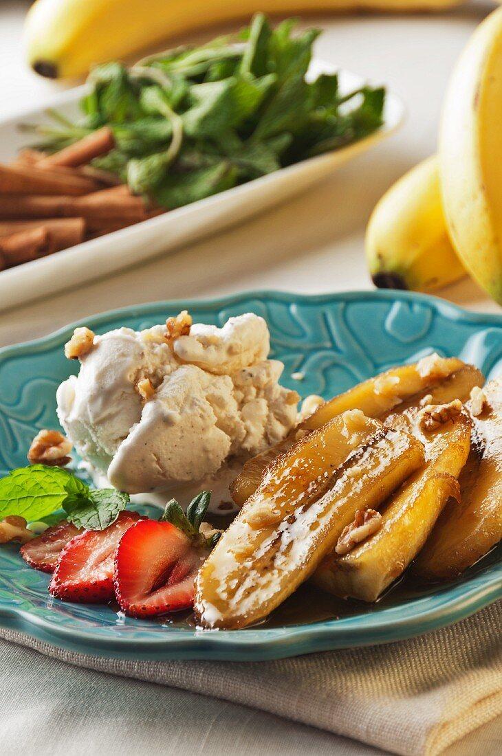 Bananas Foster with Walnuts, Strawberries, Vanilla Ice Cream and a Mint Garnish