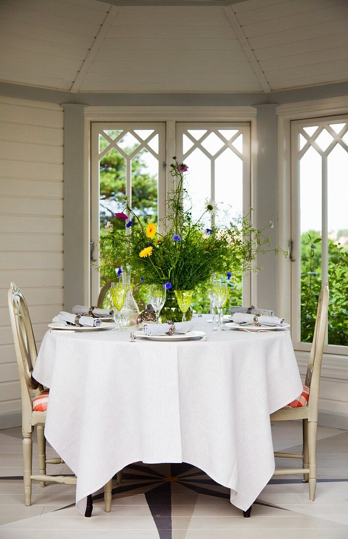 Set table in garden pavilion