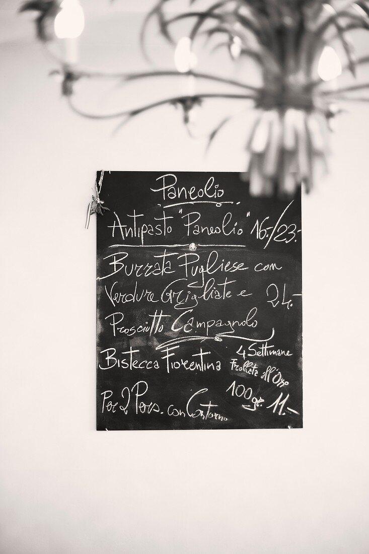 Menu of Italian restaurant on slate board
