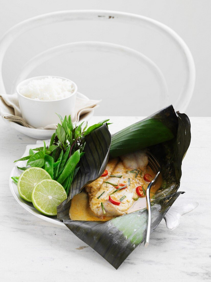 Flounder steamed in coconut milk in a banana leaf