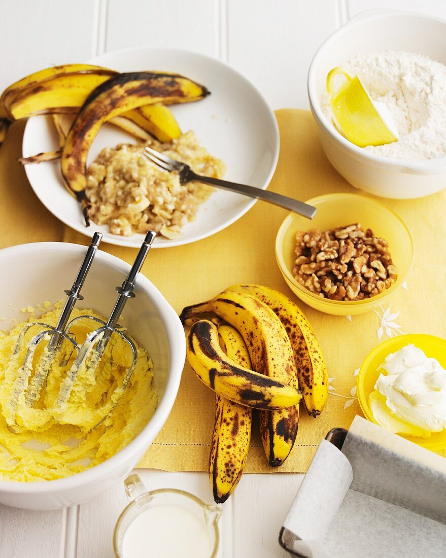 Overripe bananas and other ingredients for banana cake