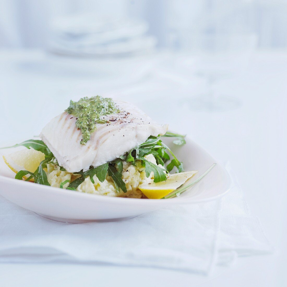Cod fillit with green sauce on a bed of garlic mashed potatoes