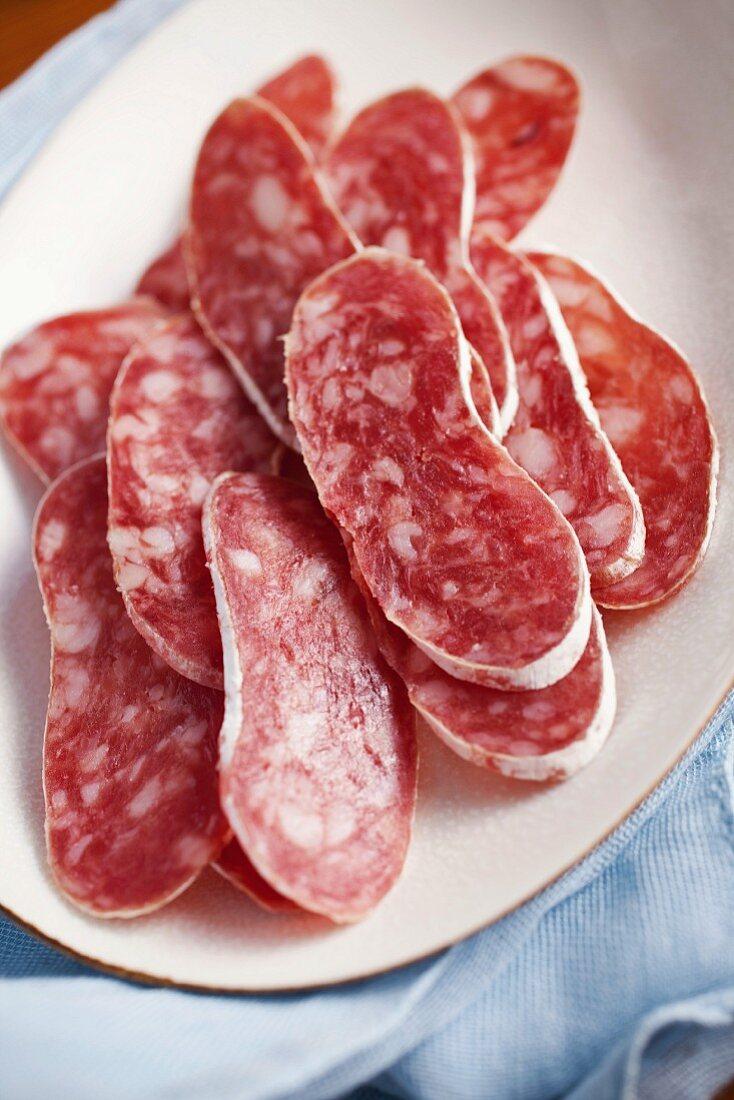 Slices of fuet salami
