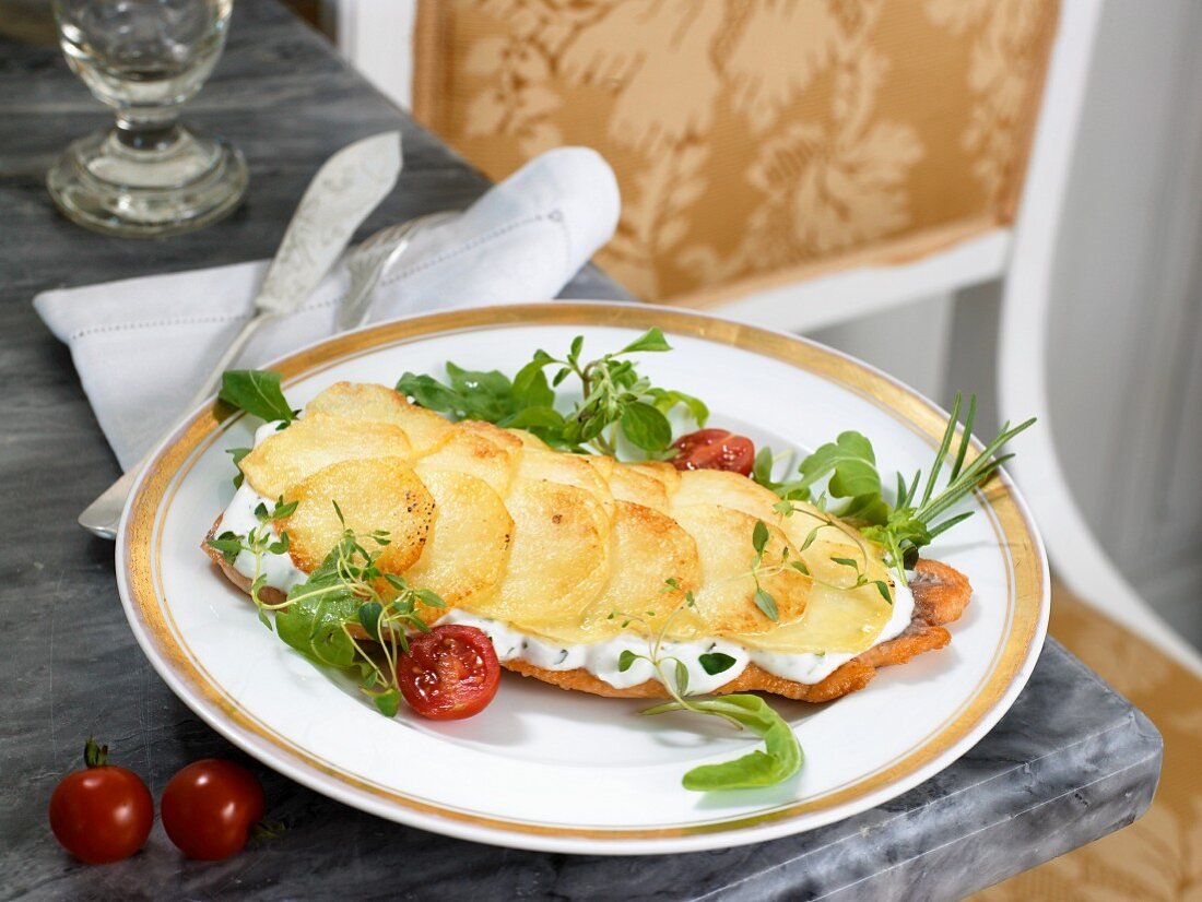 Salmon trout with herb cheese and fried potatoes