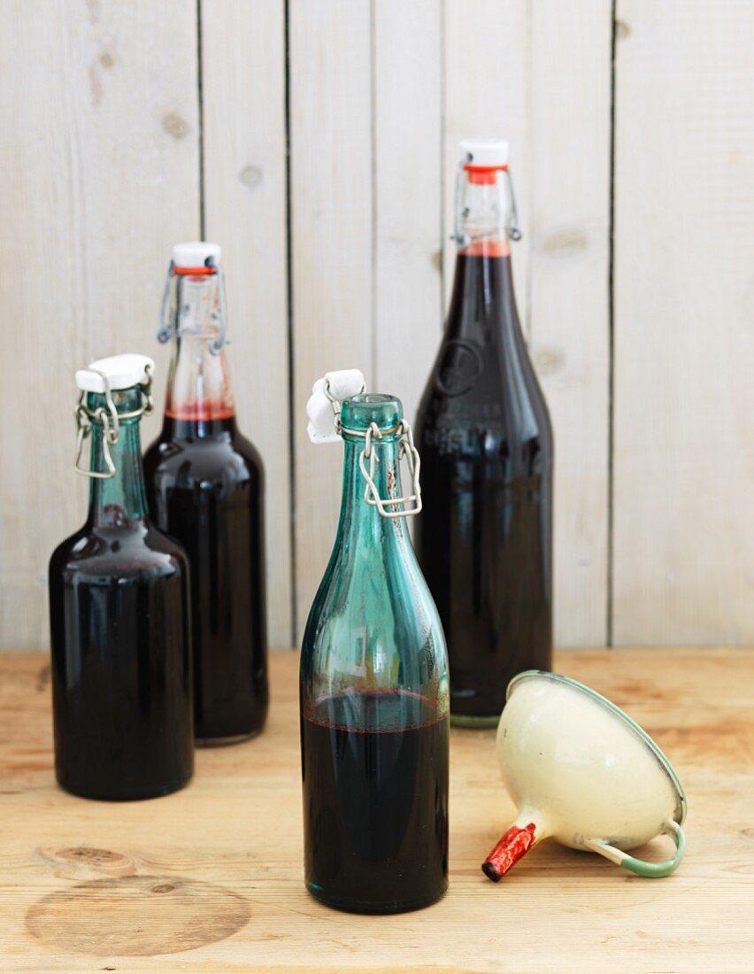 Bottles of fresh blueberry juice