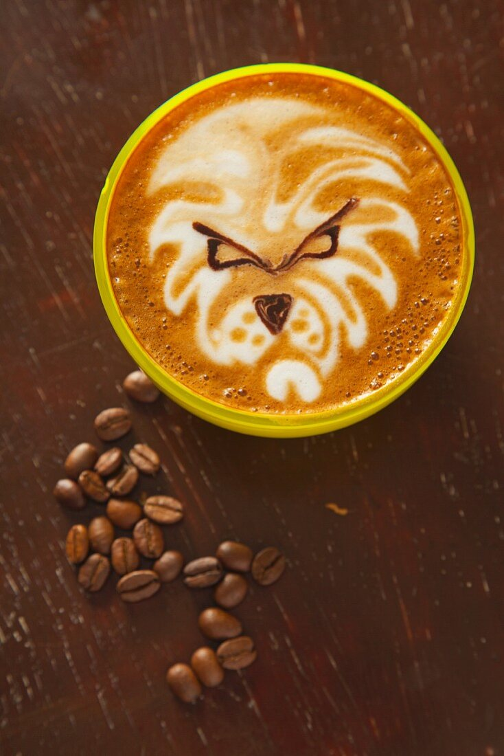 A cappuccino decorated with a lion face