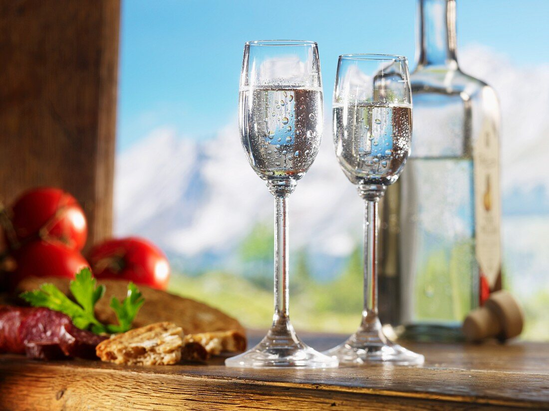 Two glasses of schnapps for supper against an alpine backdrop