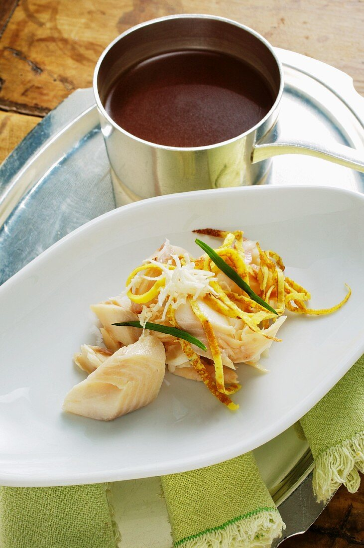Smoked trout broth and smoked trout with pancake strips