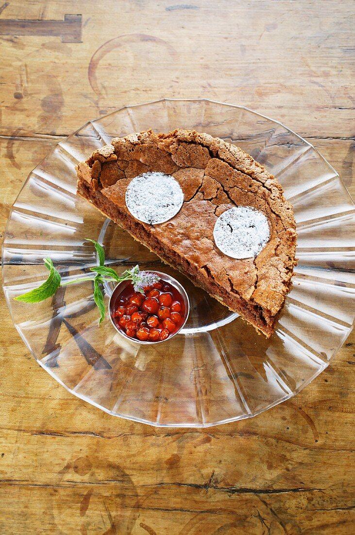 Half a walnut cake with rowan berry compote