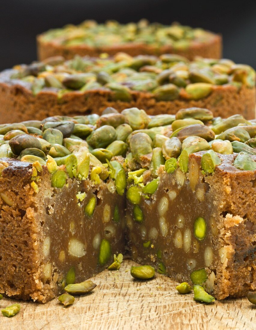 Chocolate cake with pistachios and pine nuts