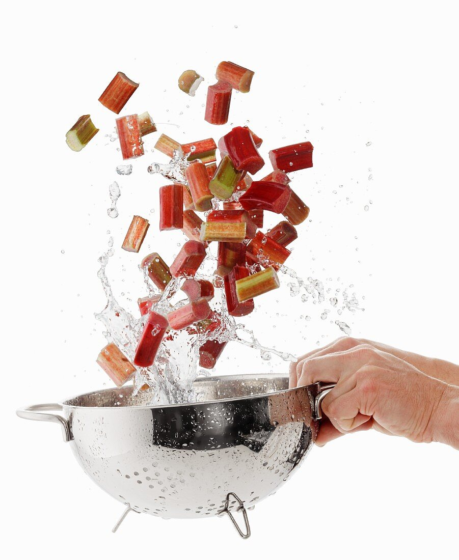 Washing rhubarb slices in a colander