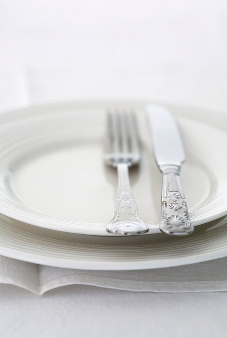 White plate with silver cutlery