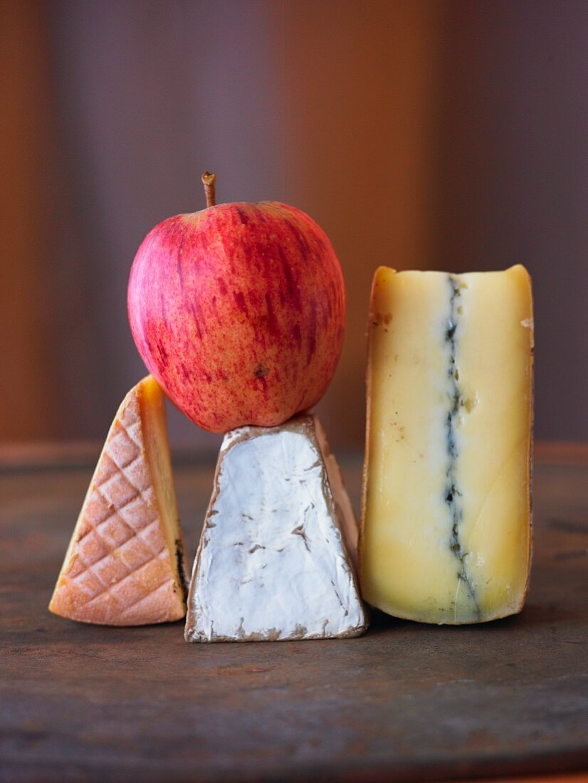 An Apple with Three Assorted Wedges of Cheese