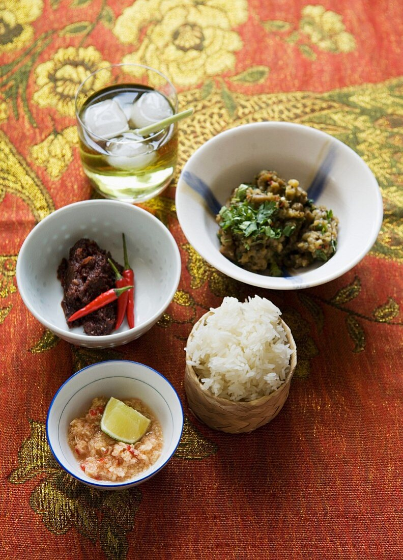 Sticky rice with aubergine dip, chilli paste (Luang Prabang Jeowbong), lemon grass dip and iced tea (Lao)