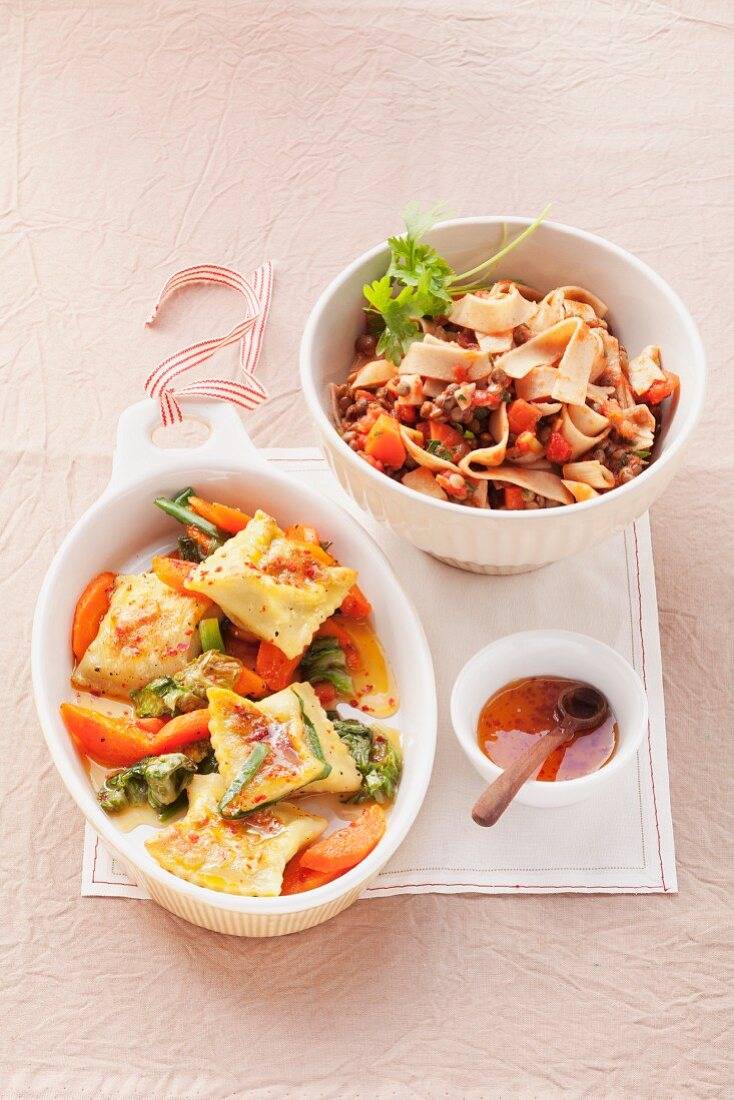 Whole wheat ribbon noodles with lentils and ravioli with vegetables and orange sauce