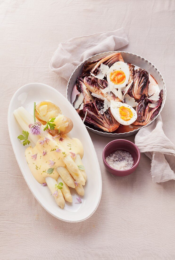 Braised radicchio with eggs and white asparagus with Hollandaise sauce and potatoes