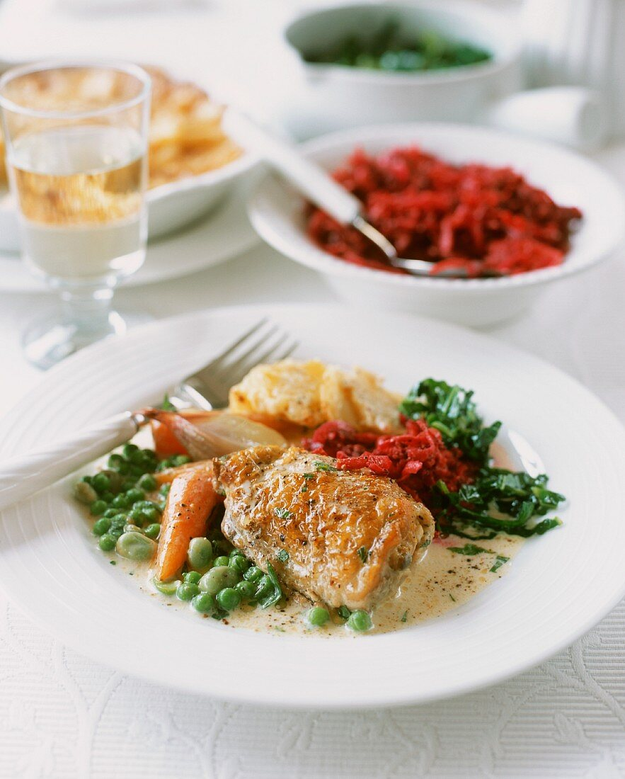 Braised chicken with spring vegetables and side dishes