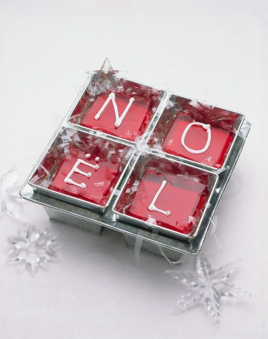 Red jelly in four moulds for Christmas