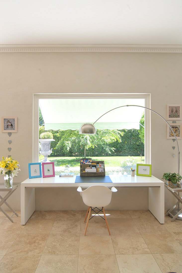Modern desk with shell chair and fifties-style arc lamp