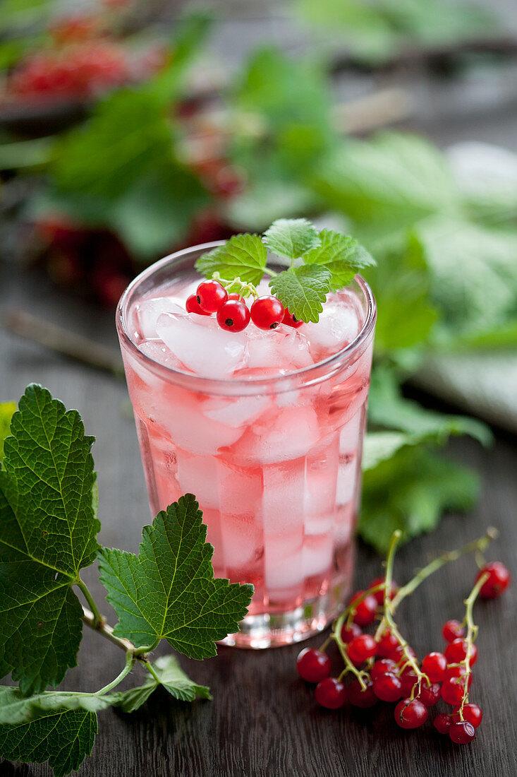 Redcurrant juice with lemon ice cubes