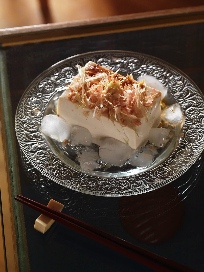 Silken tofu on ice with dried bonito flakes, ginger and spring onions (Japan)