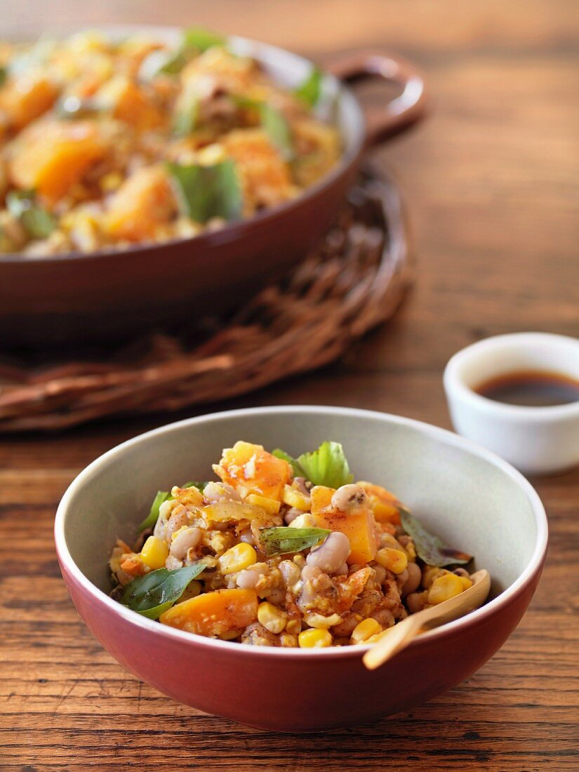 Bean and corn casserole with pepper oil