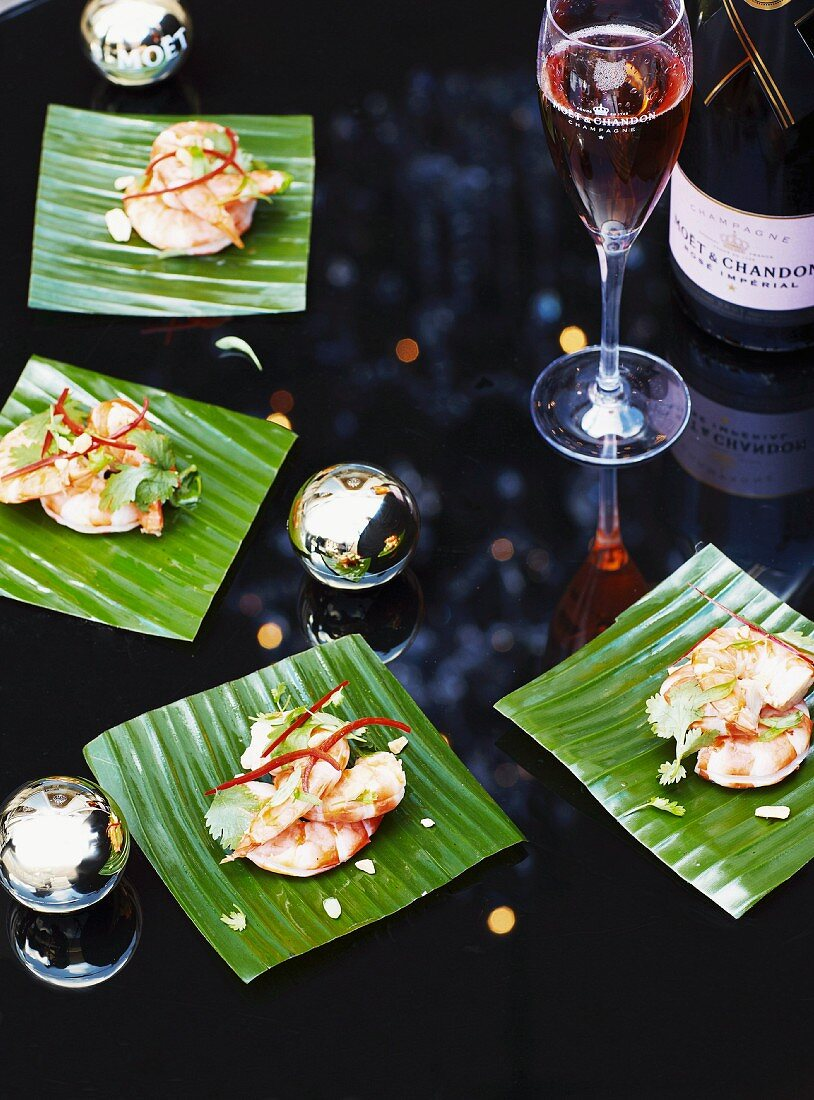 Shrimp with nam jim dressing (chili sauce, Thailand) and champagne