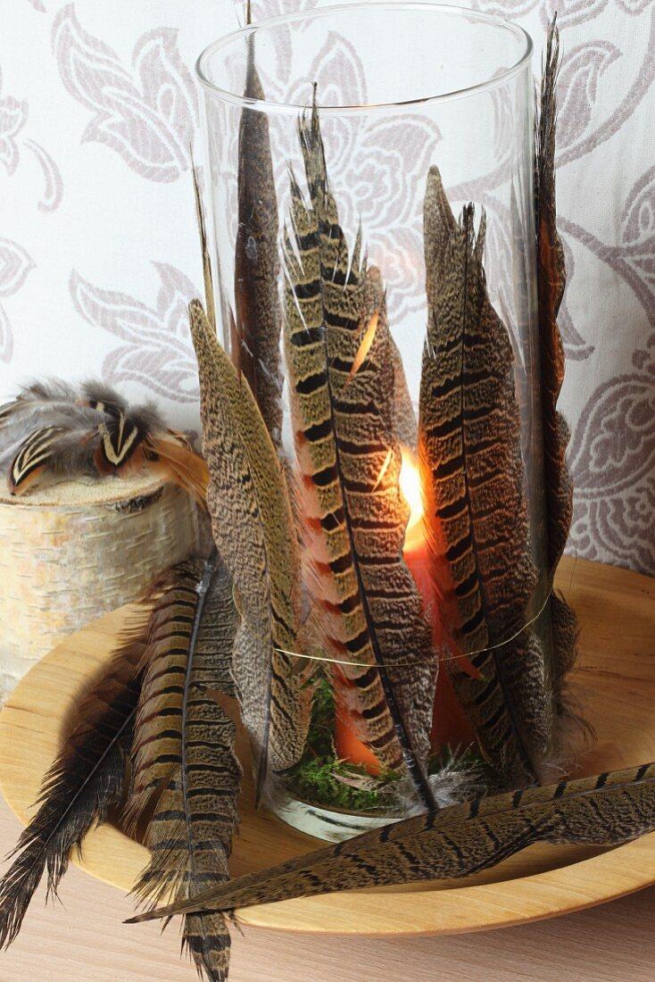 Tea light with bird feathers