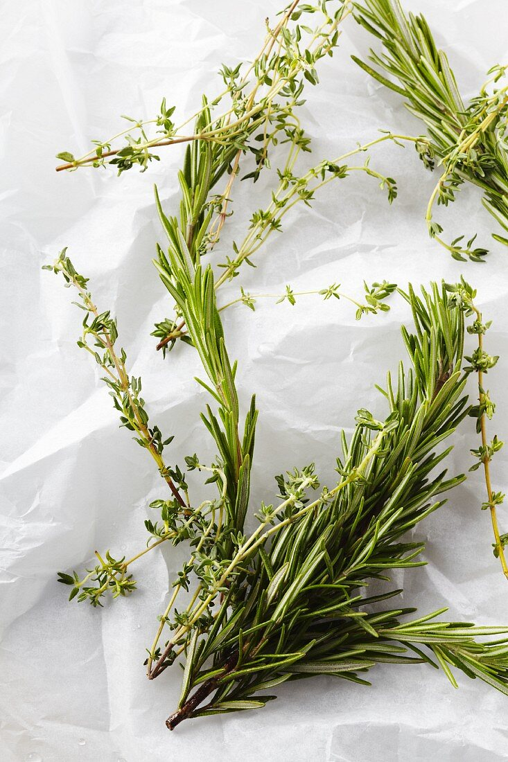Fresh Sprigs of Rosemary and Oregano on Butcher's Paper