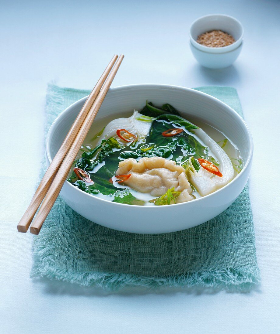 Soup with wontons, pak choi and chilli