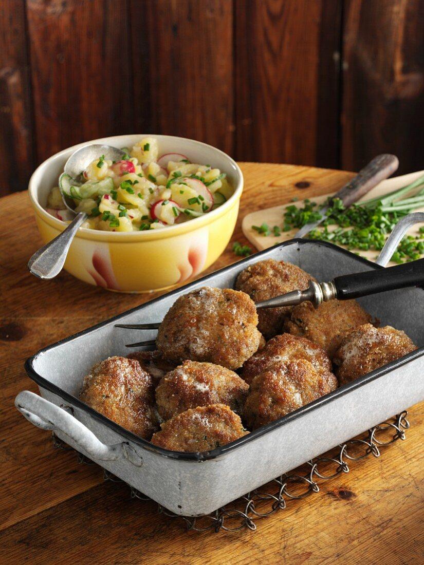 Austrian minced meat patties with potato and radish salad