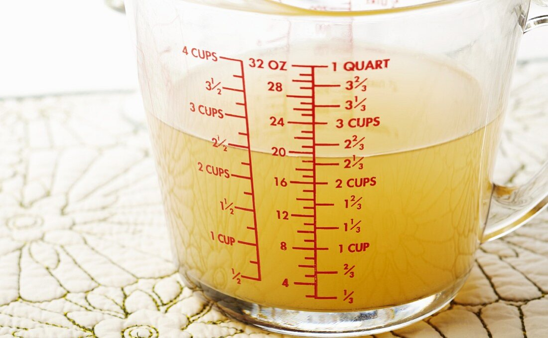 2 1/2 Cups of Chicken Broth in a Measuring Cup