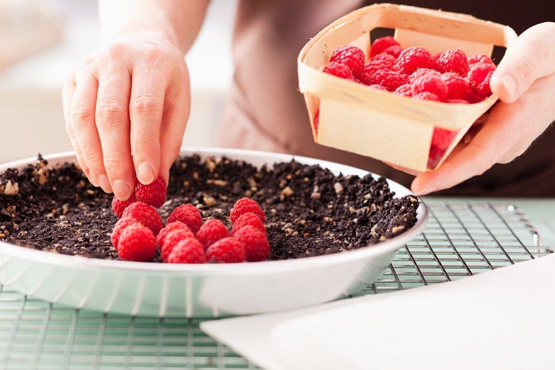 Lay fresh raspberries on biscuit base