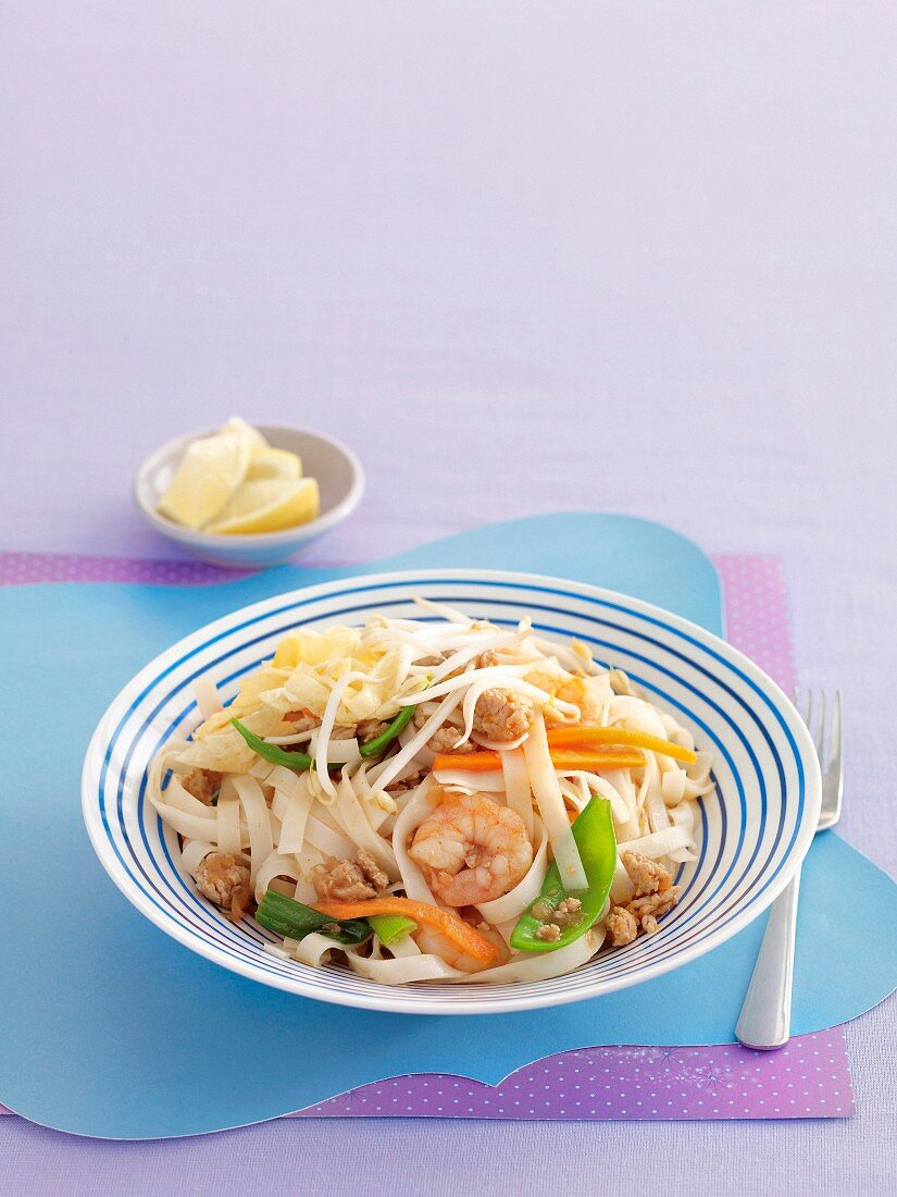 Pad Thai (fried rice noodles, Thailand) with vegetables and shrimp
