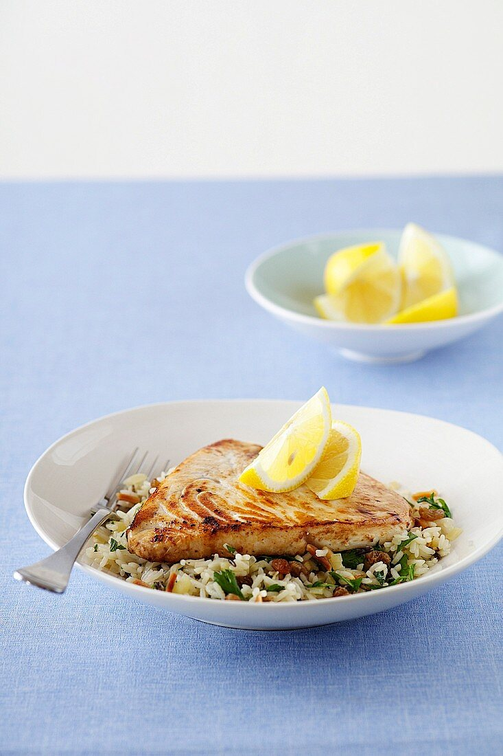 Swordfish on raisin and almond rice