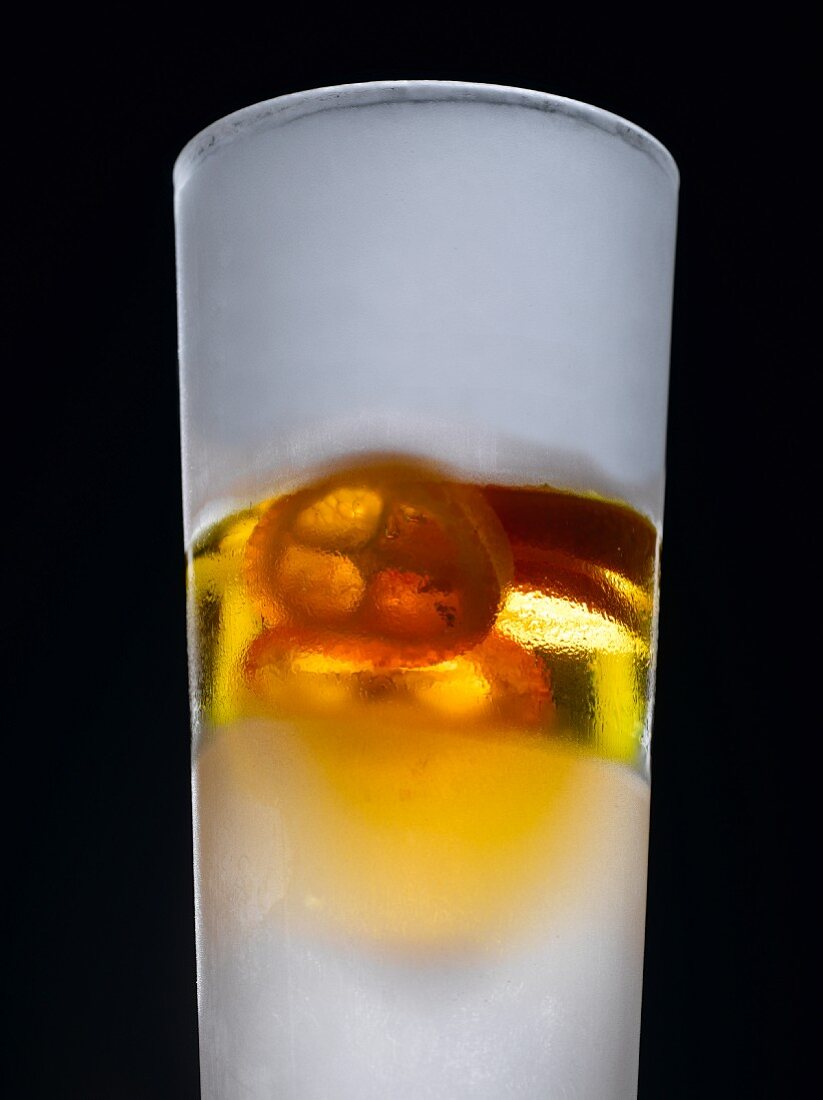 Orange liqueur in iced glass with exotic fruits