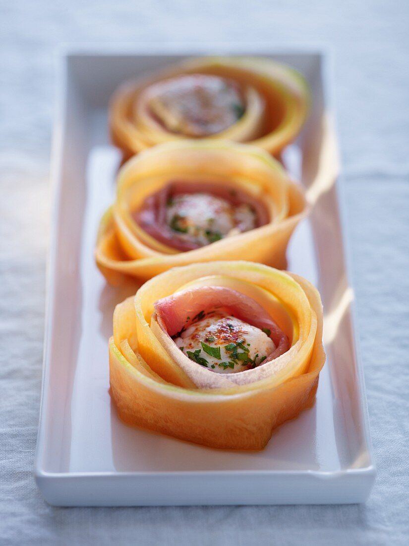 Chicken in ham and melon rolls
