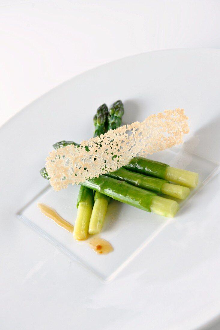 Fried asparagus with lemon sauce and parmesan shavings