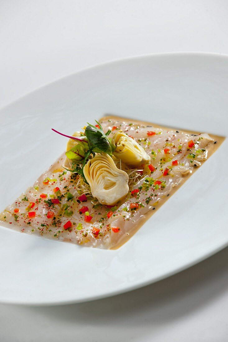 Marinated fish fillets with artichokes