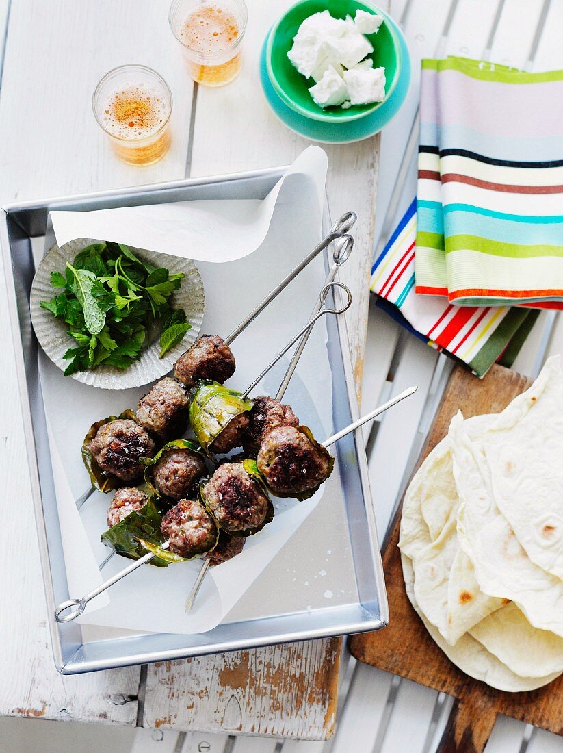 Grilled ground lamb kebabs with flat bread