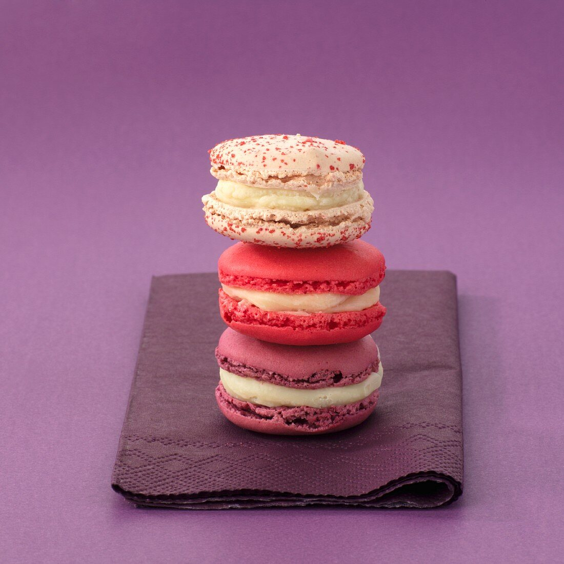 Three macarons on a serviette (stacked)