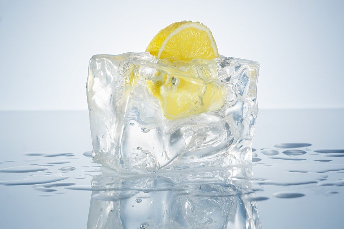 Half a lemon in a block of ice