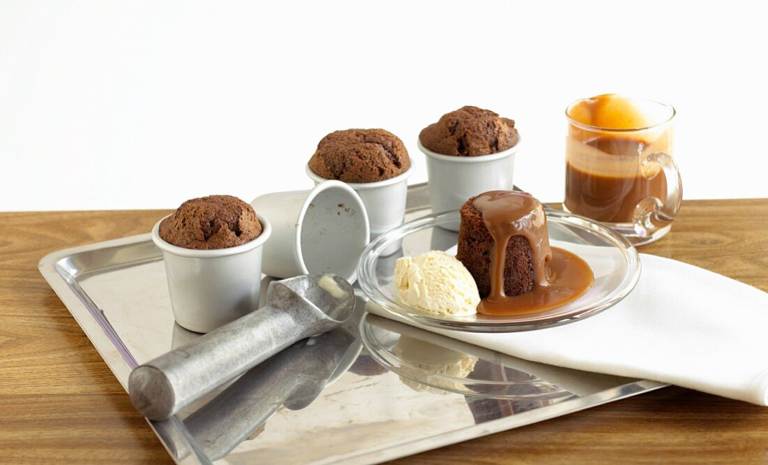 Baked chocolate pudding with fudge sauce and vanilla ice cream
