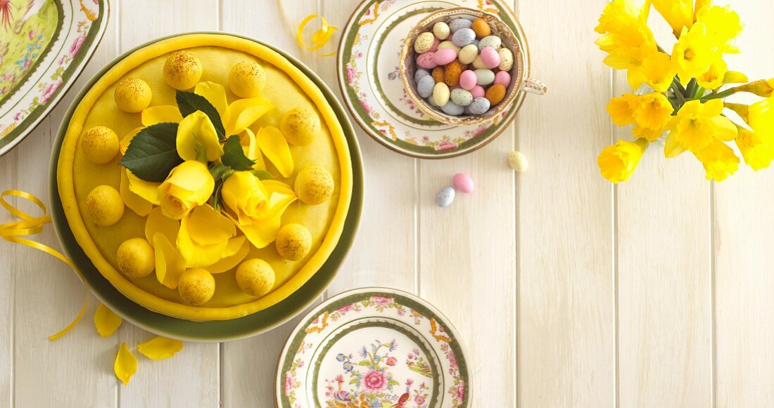 Simnel cake and sugared eggs on an Easter table (seen from above)