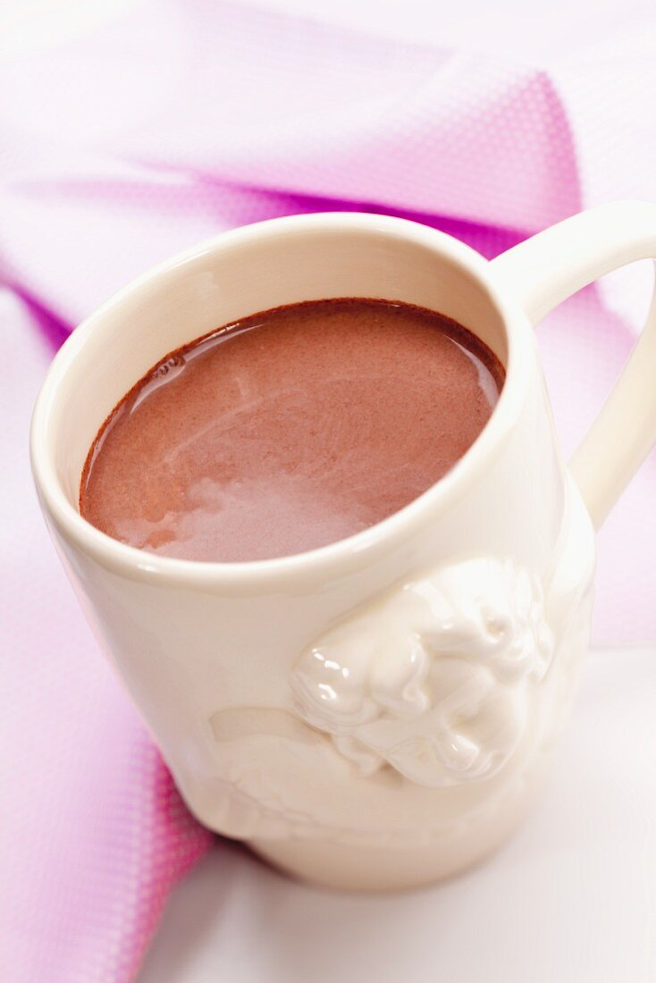 Hot chocolate in a cup with an angel motif