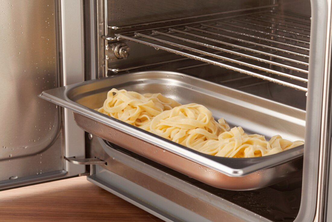 Pasta being reheated in a steamer